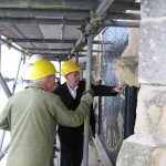 Inspecting the clock face repair as part of a major conservation project on the tower