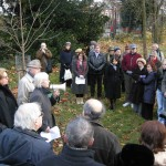 Planting a tree to commemorate a founding member, Dr Joan Schwitzer
